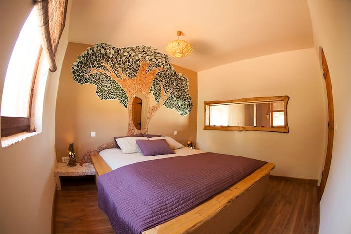Nature inspired bedroom featuring mosaic art and handmade decor