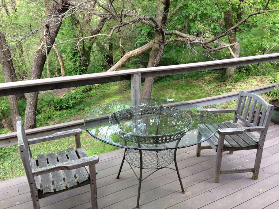 Guests are welcome to enjoy the deck overlooking the woods