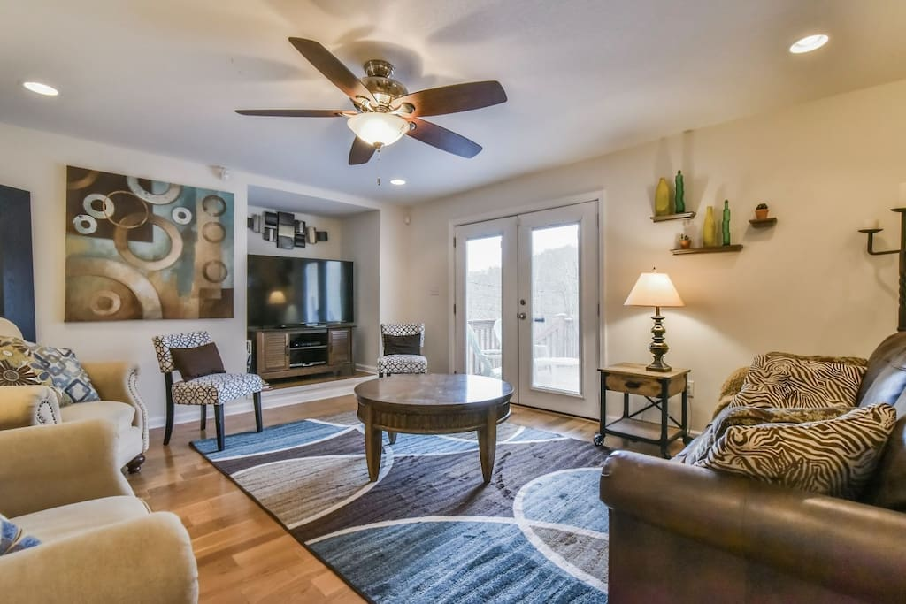 Gorgeous living room with hard wood floors and easy access to the back deck.