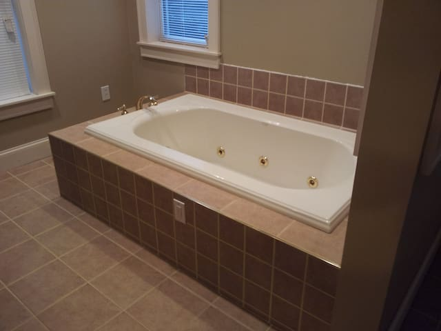 guest bath features a whirlpool tub