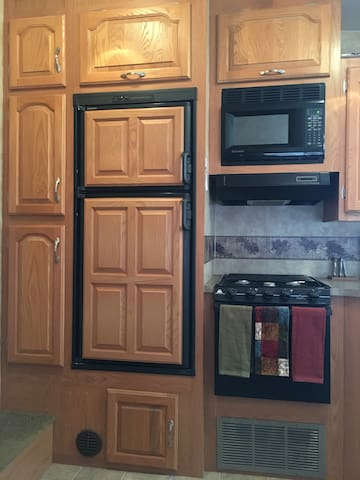 Kitchen, fridge, gas stove & microwave