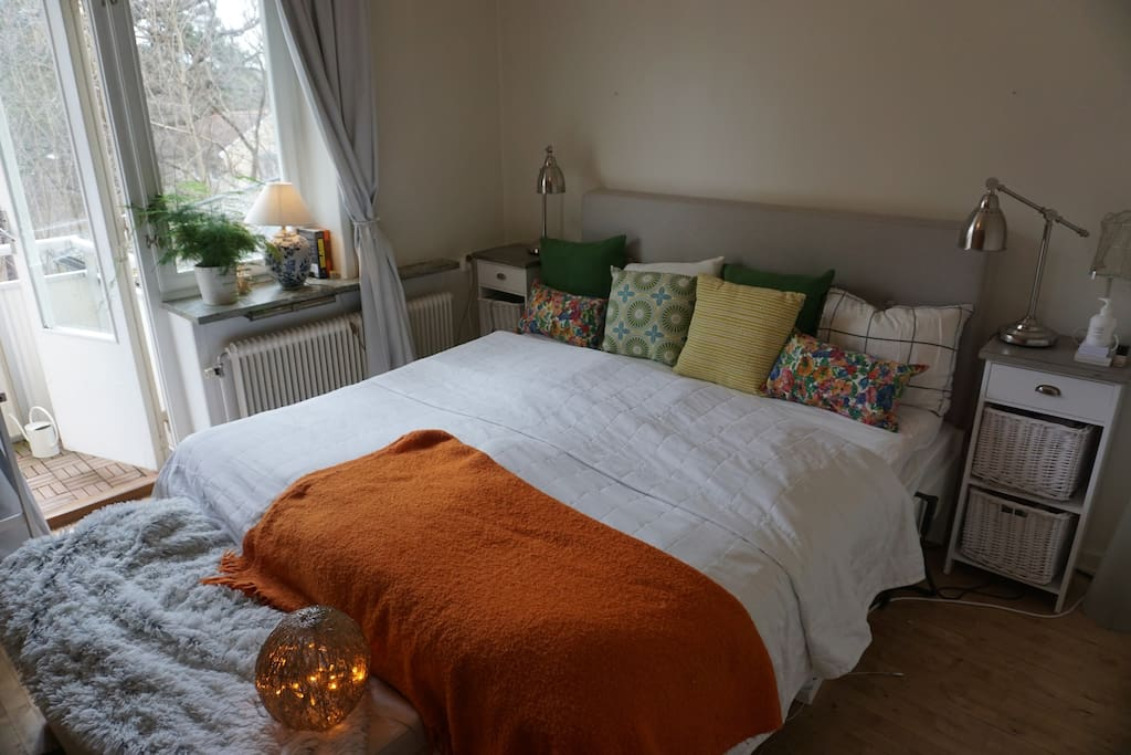 Comfortable bedroom with queensize bed and direct access to balcony with morning sun.