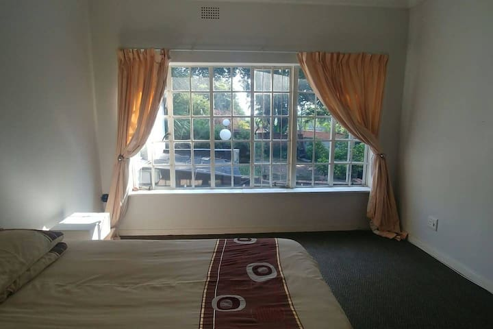 Simple Room in large house near Sandton&Melrose