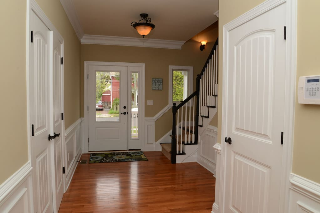 Beautiful foyer with powder room and large coat closet.