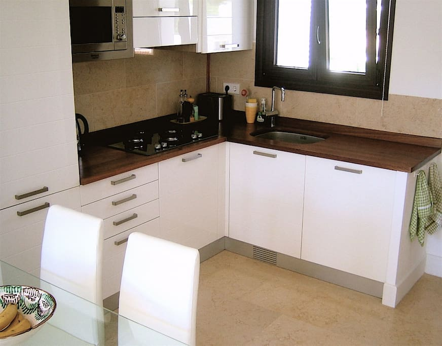 The fully equipped kitchen includes fridge/freezer, microwave, gas hob, dishwasher, washer/dryer, citrus juicer - everything you need!