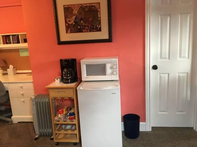 Coffee maker with complimentary coffee and tea, microwave and mini fridge