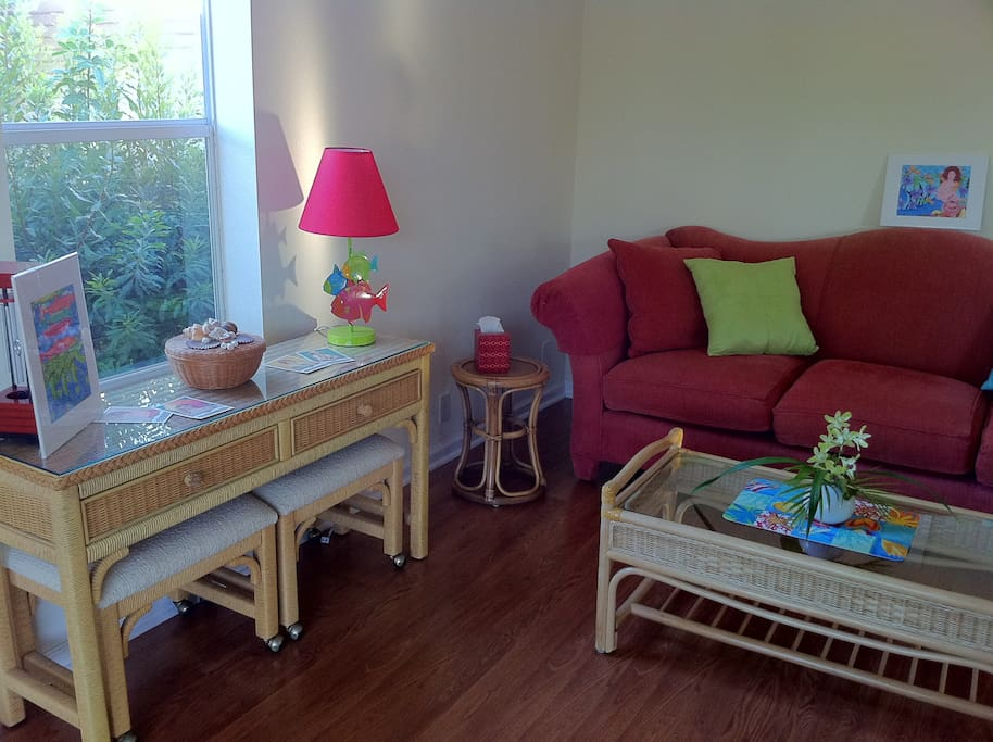 Florida style rattan makes you comfy in this bright, sunny livingroom
