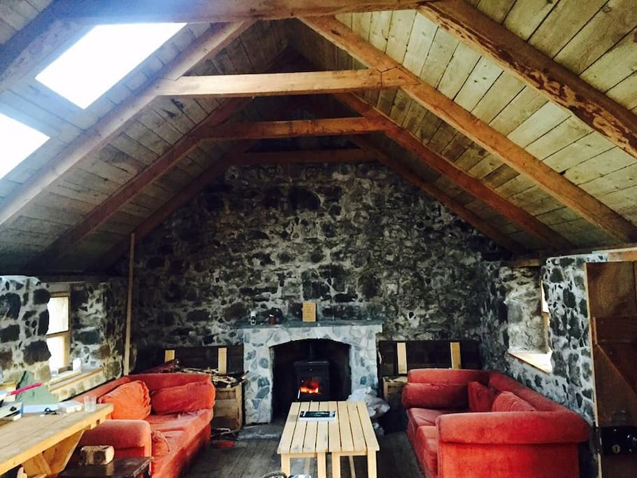 Beautifully restored stone and wood interiors with wood fire