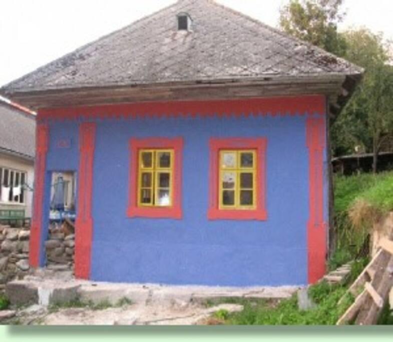 Aanzicht in traditionele kleuren van uw appartement.