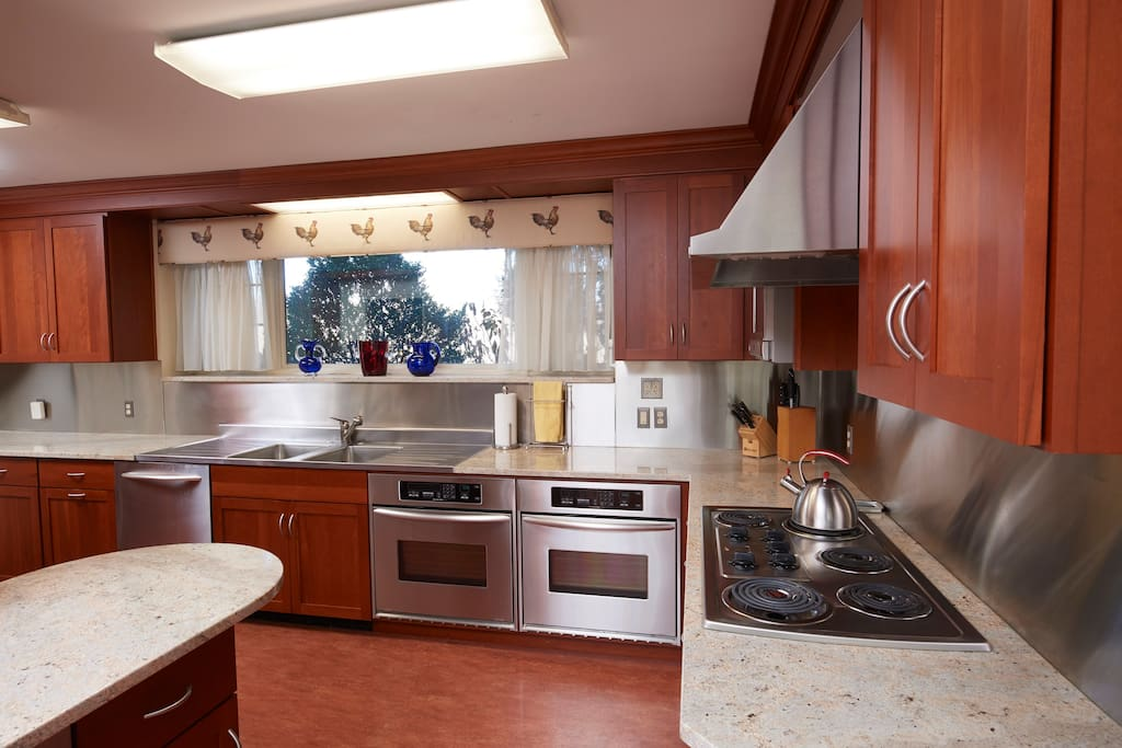 The kitchen is newly renovated with multiple ovens, a dishwasher and built in ice machine.