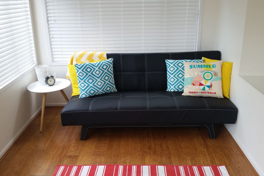 Living room - futon can be used as an extra  bed if required.