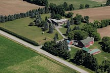 Aerial view of Old Stone House Farm's 8.5 acres. Photo taken 2 days after purchase before flower beds were started.