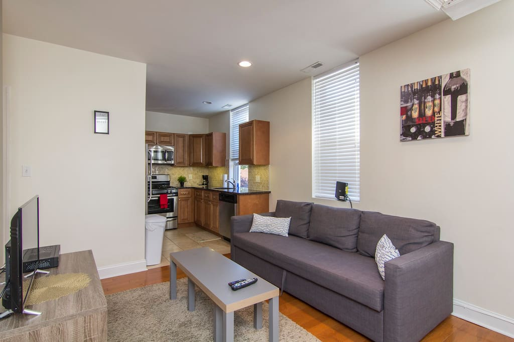 The living room is furnished with comfy sofas and seating so that whether you've spent the day at the Liberty Bell, climbing the art museum steps, or on an adventure to find the best cheesesteak in Philly, you will have a relaxing atmosphere to come back to.
