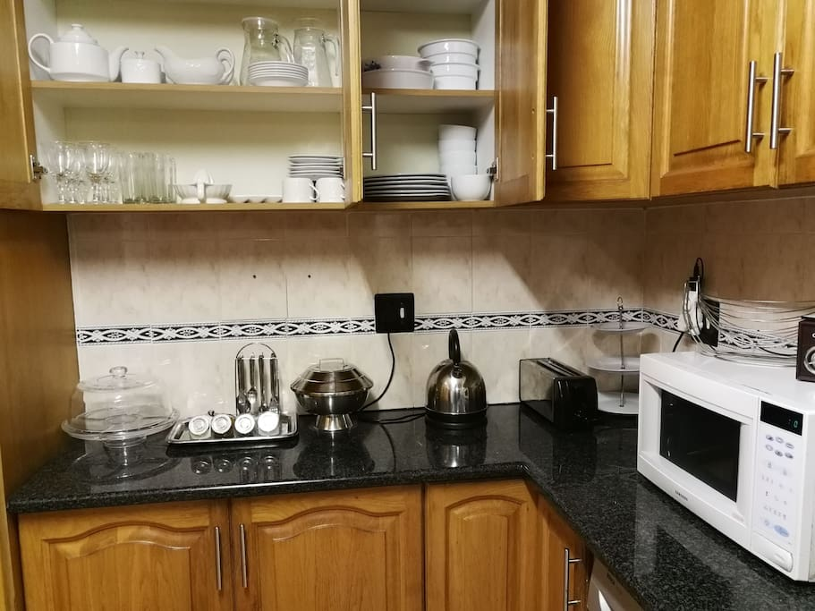 Shared kitchen space with basic amenities for 6 guests