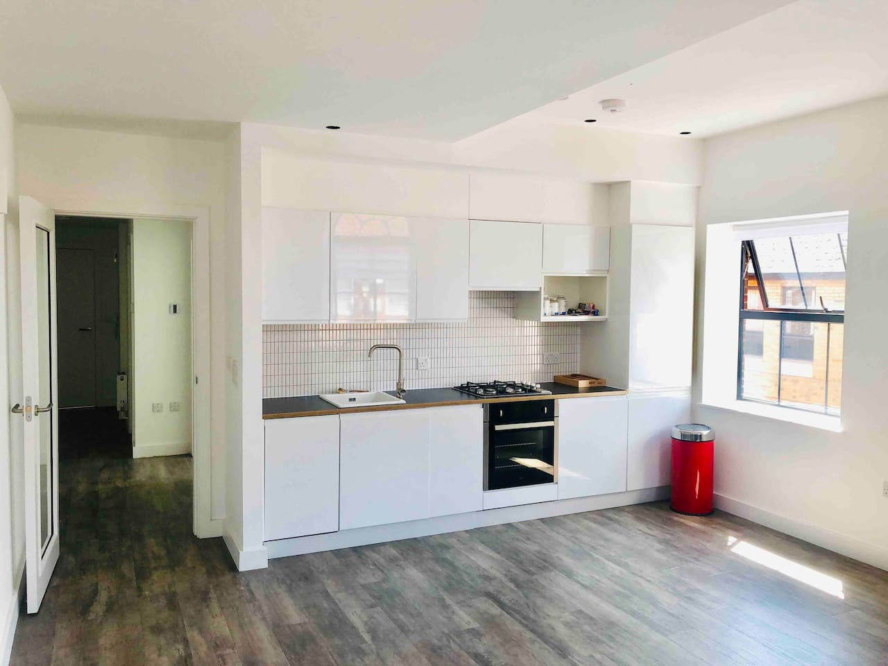 Large, bright and spacious open plan kitchen with a view over the center of Oxford.
