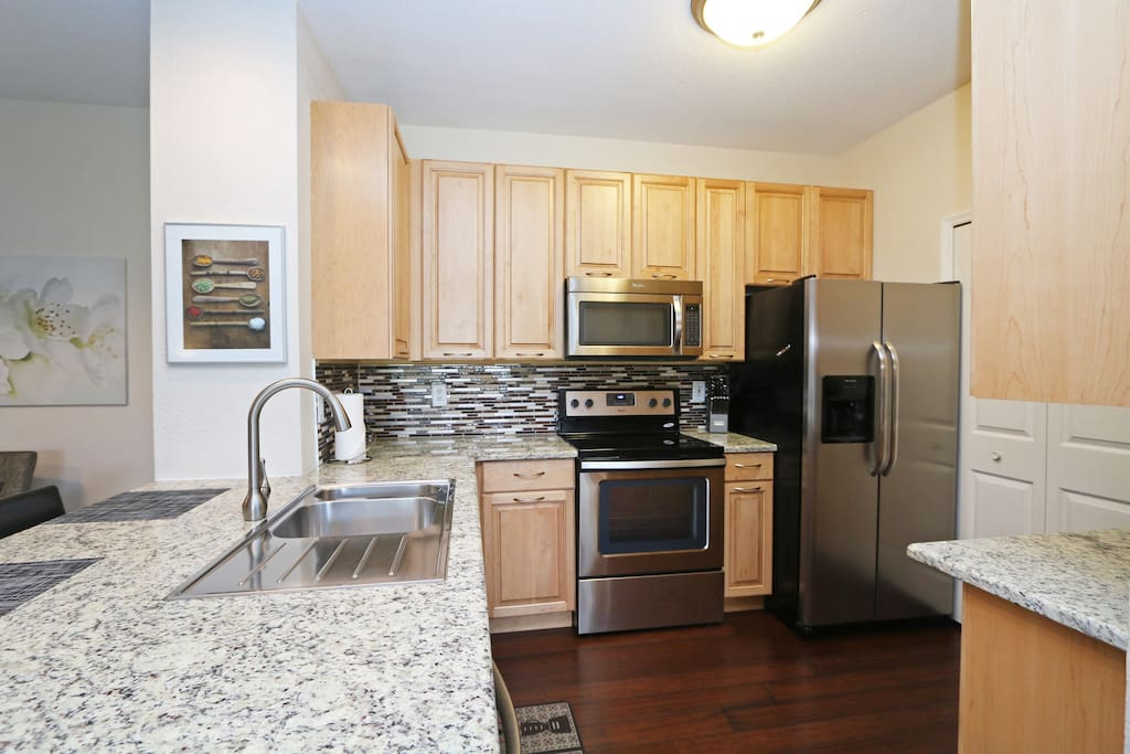 Newly remodeled kitchen with new appliances, solid maple wood kitchen cabinets
