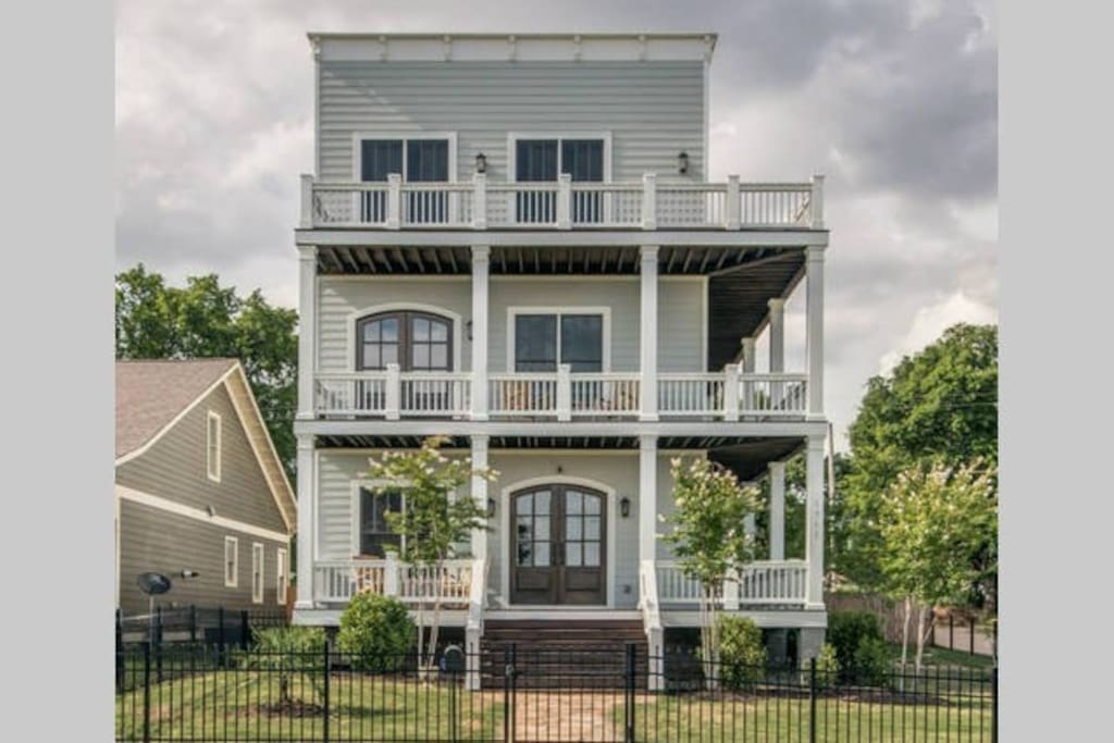 3 storys of wrap around porches back deck and rooftop deck on this incredible home with so many outdoor amenities.