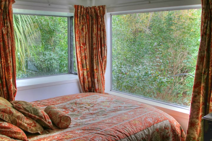 Bedroom view to bush and stream (and trout if you're lucky!).