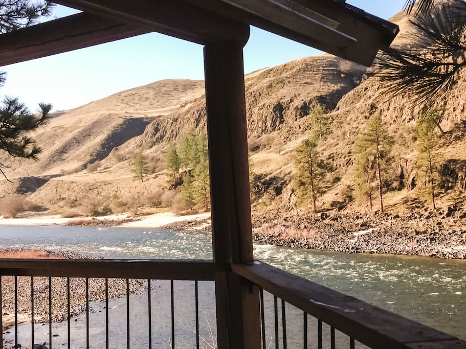 View of the Front Deck which overhangs the Salmon River and a good private fishing hole.