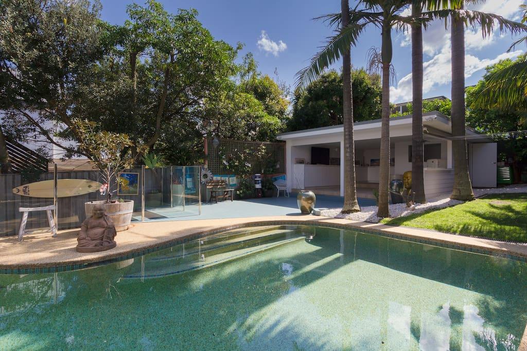 Pool and cabana from backyard