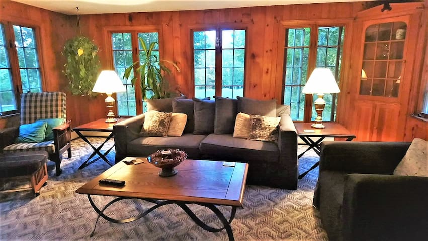 Relax in the spacious living room and enjoy the tranquil privacy of this secluded property. The large couch also makes a comfortable single bed.