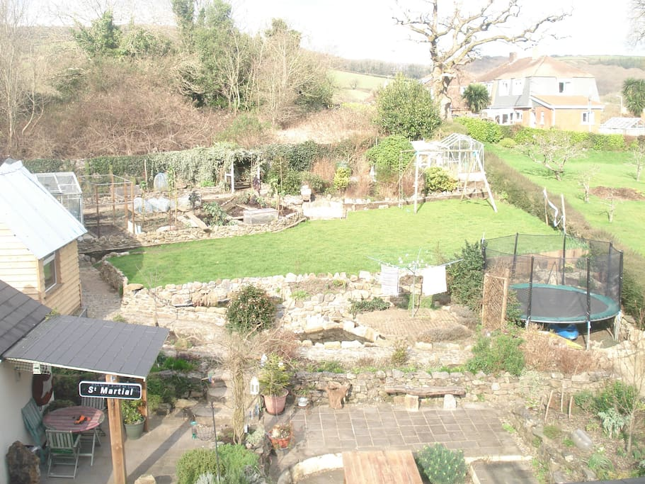 Our garden with an area for outdoor eating and a big trampoline for the children