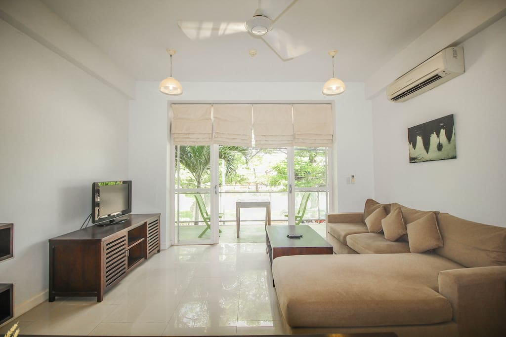 Living room with Central river view balcony