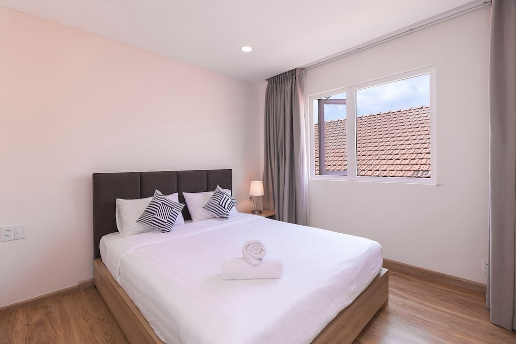 Simple but elegant bedroom, filled with natural light
