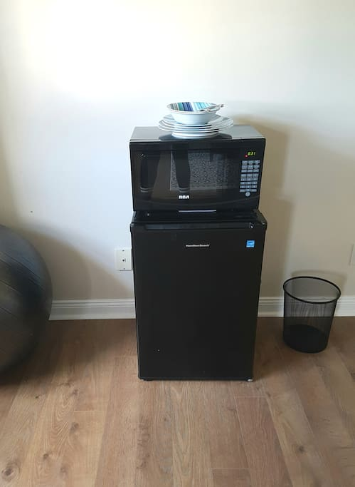 Microwave, dishes, fridge