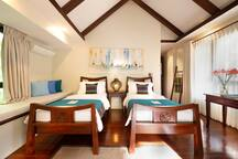 Bedroom 2: It has its balcony with lush views facing the front gardens and mountain.