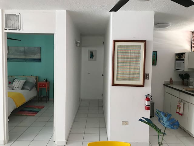 Here is a picture of one of the entrances to the bedroom. In the middle there is a hallway which ends with the bathroom to the right and a second entrance to the bedroom to the left. The kitchen is the one to the far right.
