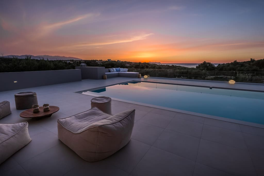 Enjoy amazing sunsets in the lounge area next to the pool