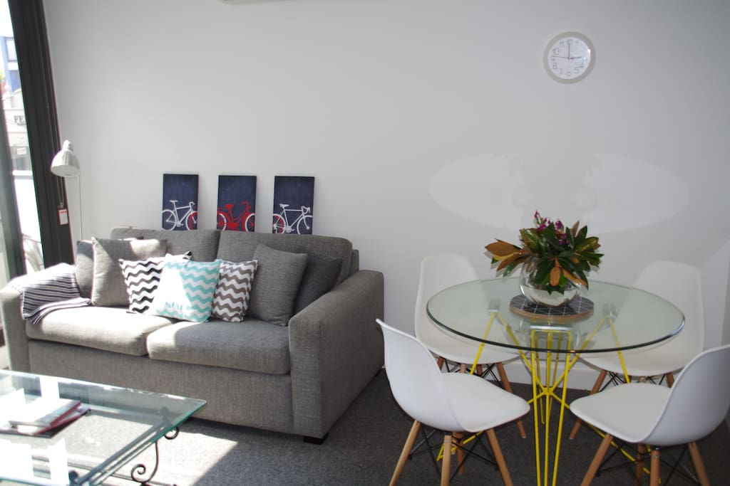 Beautiful cosy living room with lots of natural light and access to large balcony