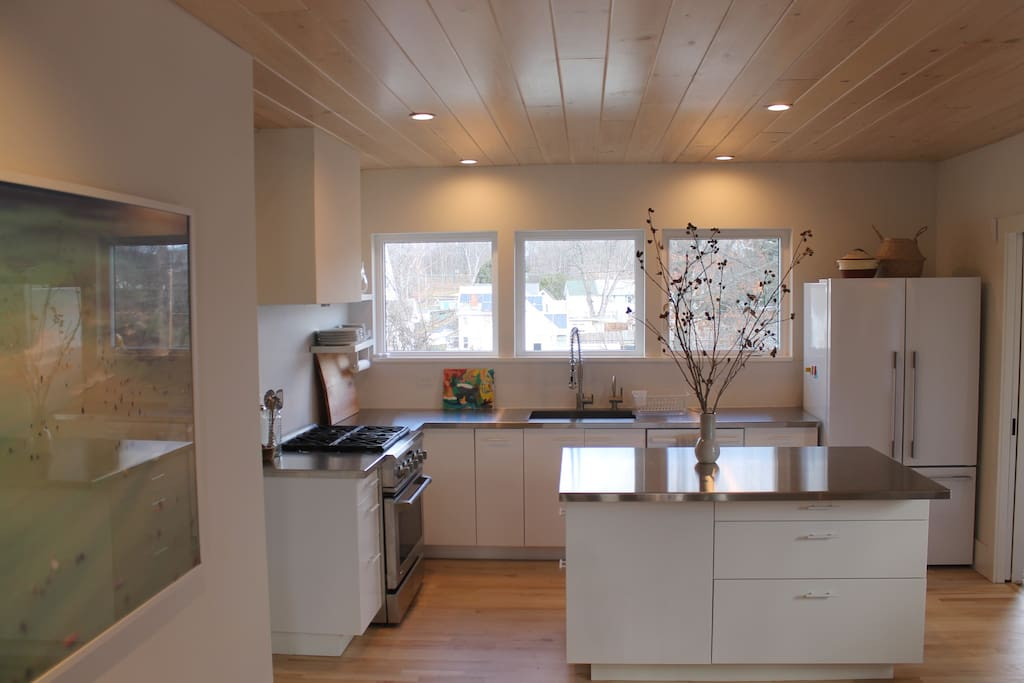 Open airy floor plan downstairs. Gourmet chef's kitchen with high-end appliances, stainless steel countertops, instant hot/cold filtered water, and natural light galore.
