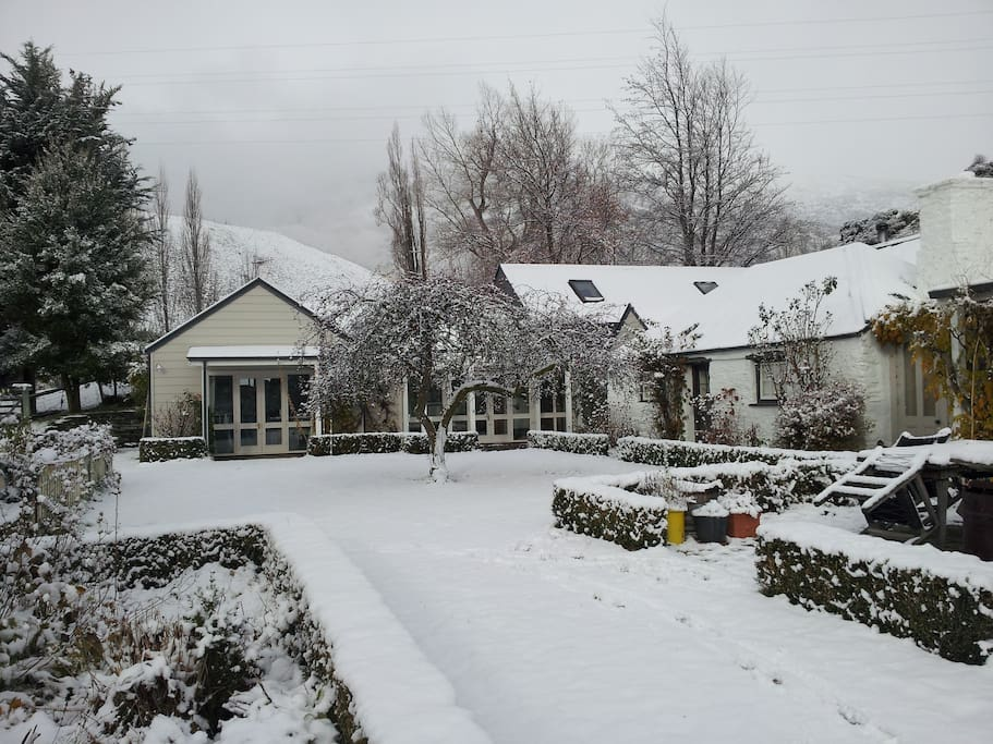 Old cottage and guest wing under snow