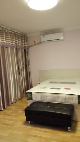 tony的现代公寓 - Циндао - Квартира