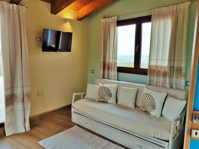 Large bedroom with TV and sea view over the Costa Smeralda, Sardinia