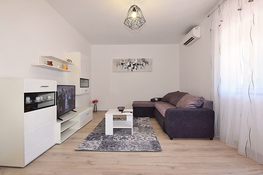living room with sofa for extra person