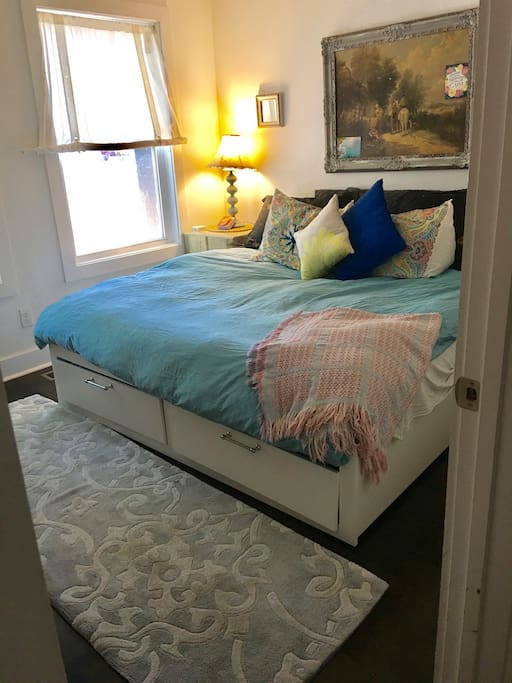 """the twin bed(s) convert to a king bed with a feather topper, and down comforter with a duvet. It is super comfy! (see Ikea """"Brimness"""" bed for specs)"""