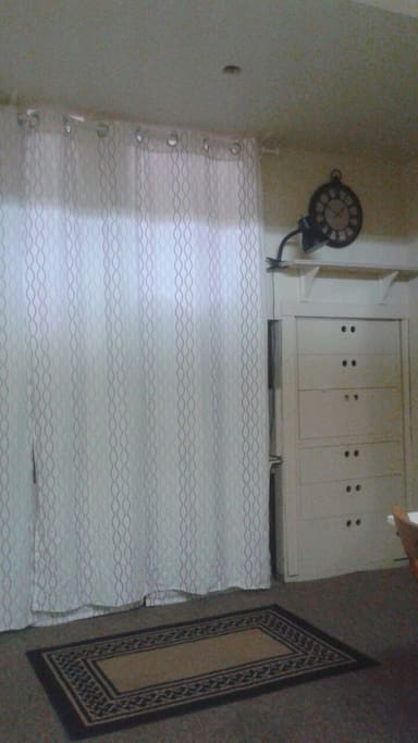 These lovely curtains close to hide TV and give privacy