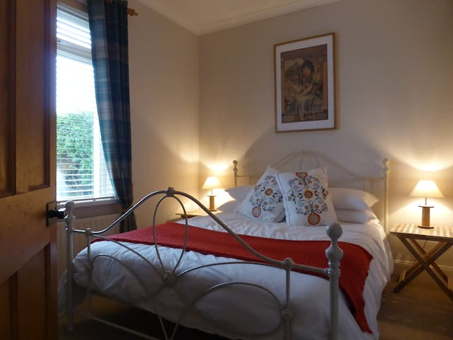 Bedroom 1 (ground floor): king size bed with crisp white sheets, snugly duvet and pocket sprung mattress for extra comfort.