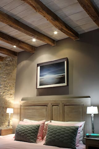 Room 1 limited edition prints and individually designed interior including rustic door headboard