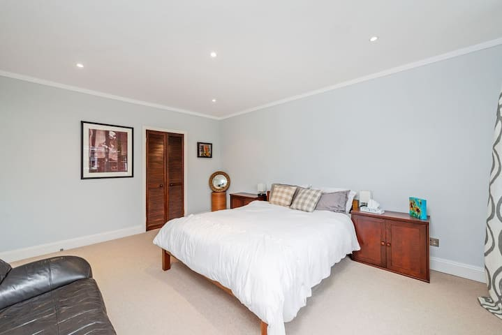 First floor master bedroom with walk in closet