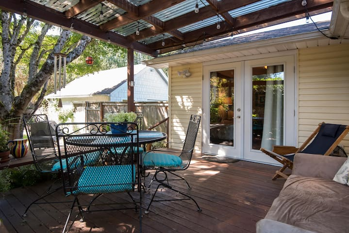 Shared space back deck with private entrance to room.