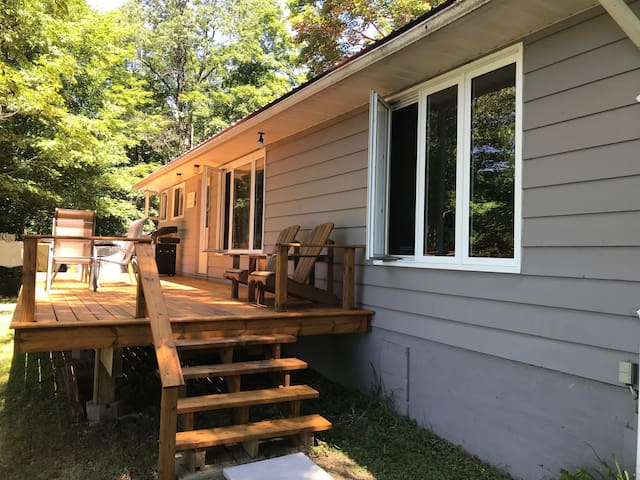 Front of cottage and deck-facing the lake