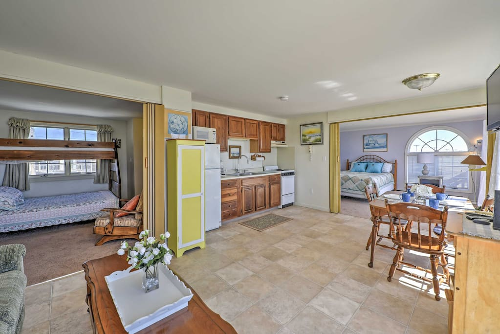 This fully equipped kitchen features an oven, stove top, and microwave for all of your cooking needs.