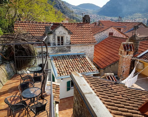 Our house features 2-level shared terrace with magnificent views of Old Town and Kotor Bay where on sunny days you can enjoy your coffee and have rooftop vistas with a sea view from one side, St. Tryphon Cathedral from another and Fortress behind you