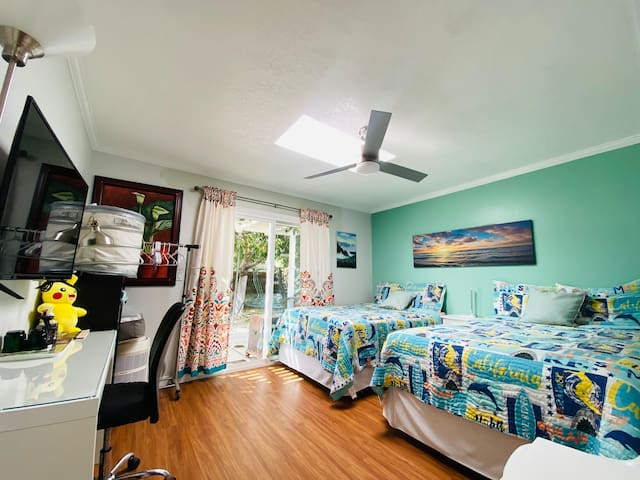 Spacious room with sliding door opening to a beautiful garden.