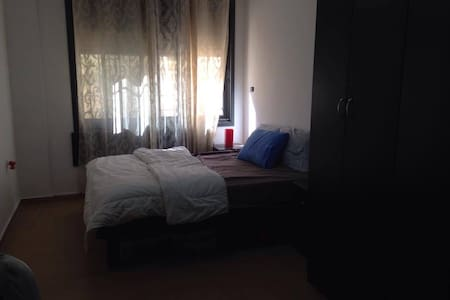 Private room in a lovely flat near city center - Ramallah - Leilighet