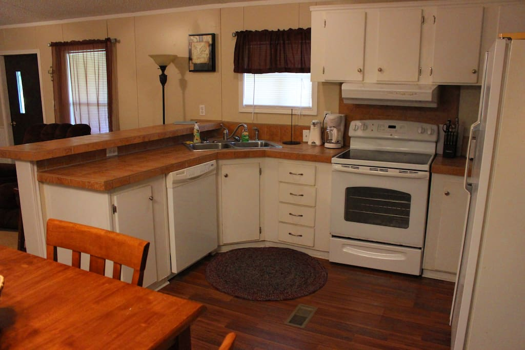 You will enjoy the fully equipped kitchen with all the pots and pans, as well as dishes that you will need.